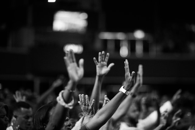 Crowd of hands raised in worship